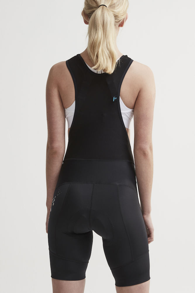 1907135_999000_Essence Bib Shorts_Femme, Cycliste doux, extensible et ergonomique • Production durable - Polyamide recyclée • Evacuation optimale de la transpiration • Lycra - compression Sport Energy avec tissage extensible quadri directionnel • Finitions bandes élastiques larges • Avec relief silicone pour une meilleure tenue • Finitions rétro-réfléchissantes • Renfort de selle 3D, Craft, 109 t-shirts